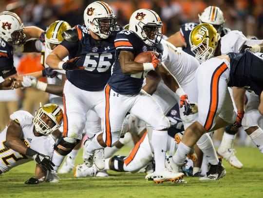 Auburn's Shaun Shivers (25) runs through the Alabama State defense at Jordan-Hare Stadium in Auburn, Ala., on Saturday, Sept. 8, 2018. Auburn defeated Alabama State 63-9.