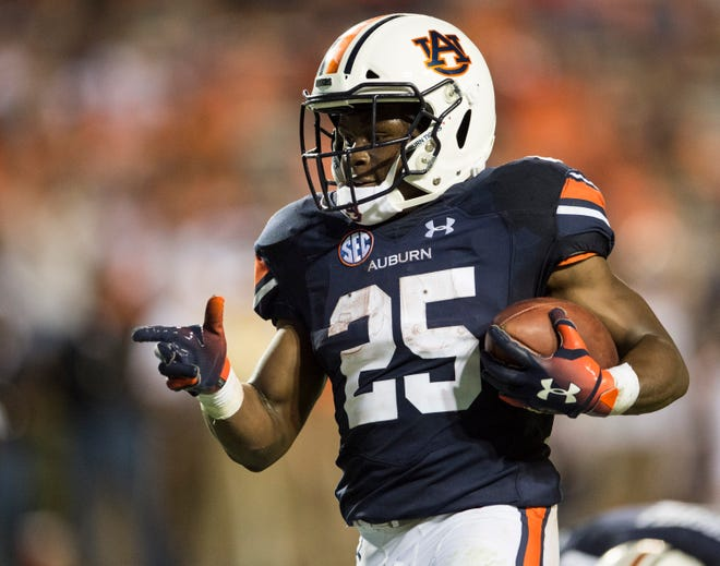Auburn's Shaun Shivers (25) celebrates as he jogs in for a touchdown against Alabama State at Jordan-Hare Stadium in Auburn, Ala., on Saturday, Sept. 8, 2018. Auburn defeated Alabama State 63-9.