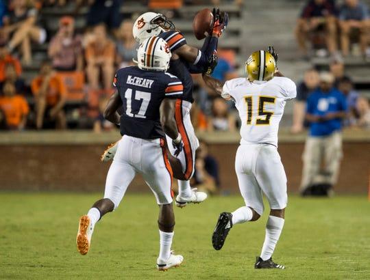 Auburn's Jamien Sherwood (9) intercepts the ball intended for Alabama State's Joe Williams IV (15) at Jordan-Hare Stadium in Auburn, Ala., on Saturday, Sept. 8, 2018. Auburn defeated Alabama State 63-9.