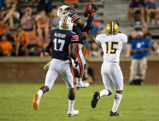 Auburn's Jamien Sherwood (9) intercepts the ball intended for Alabama State's Joe Williams IV (15) at Jordan-Hare Stadium in Auburn, Ala., on Saturday, Sept. 8, 2018. Auburn defeated Alabama State 63-9.