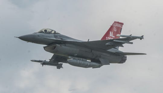 A red-tailed F-16 flies over during Red Tails Over Montgomery on Saturday, Sept. 8, 2018, at Dannelly Field in Montgomery, home of the Alabama Air National Guard's 187th Fighter Squadron.