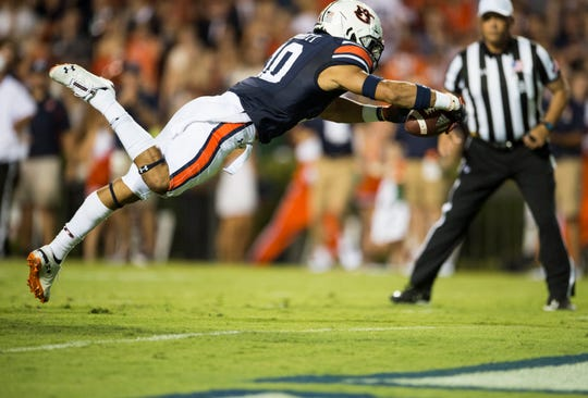Auburn's Devan Barrett (10) dives into the end zone after recovering a blocked punt against Alabama State at Jordan-Hare Stadium in Auburn, Ala., on Saturday, Sept. 8, 2018. Auburn leads Alabama State 42-2 at halftime.
