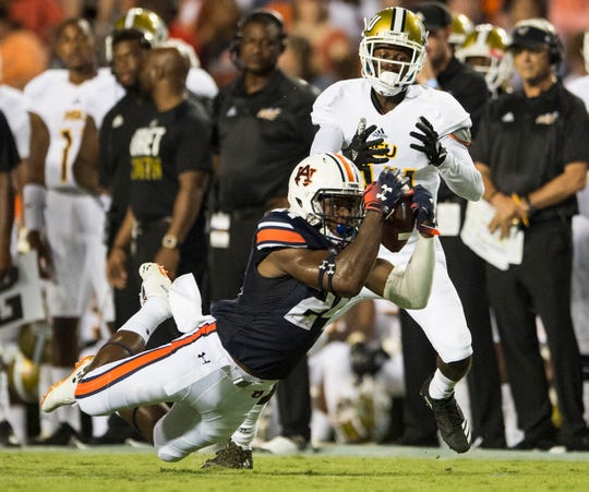 Auburn's Daniel Thomas (24) pulls down an interception against Alabama State at Jordan-Hare Stadium in Auburn, Ala., on Saturday, Sept. 8, 2018.