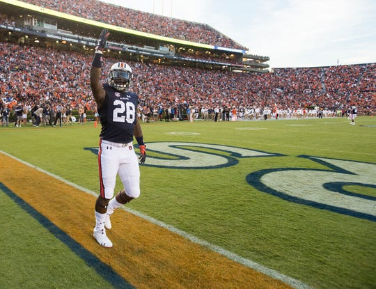 Auburn's JaTarvious Whitlow (28) pumps up the crowd before receiving the opening kickoff at Jordan-Hare Stadium in Auburn, Ala., on Saturday, Sept. 8, 2018. Auburn defeated Alabama State 63-9.