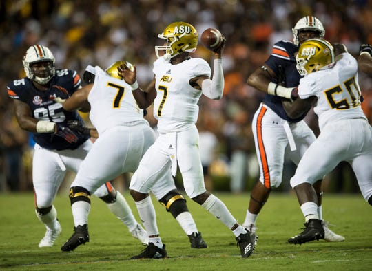 Alabama State's Darryl Pearson, Jr. (7) throws the ball against  Auburn at Jordan-Hare Stadium in Auburn, Ala., on Saturday, Sept. 8, 2018. Auburn defeated Alabama State 63-9.