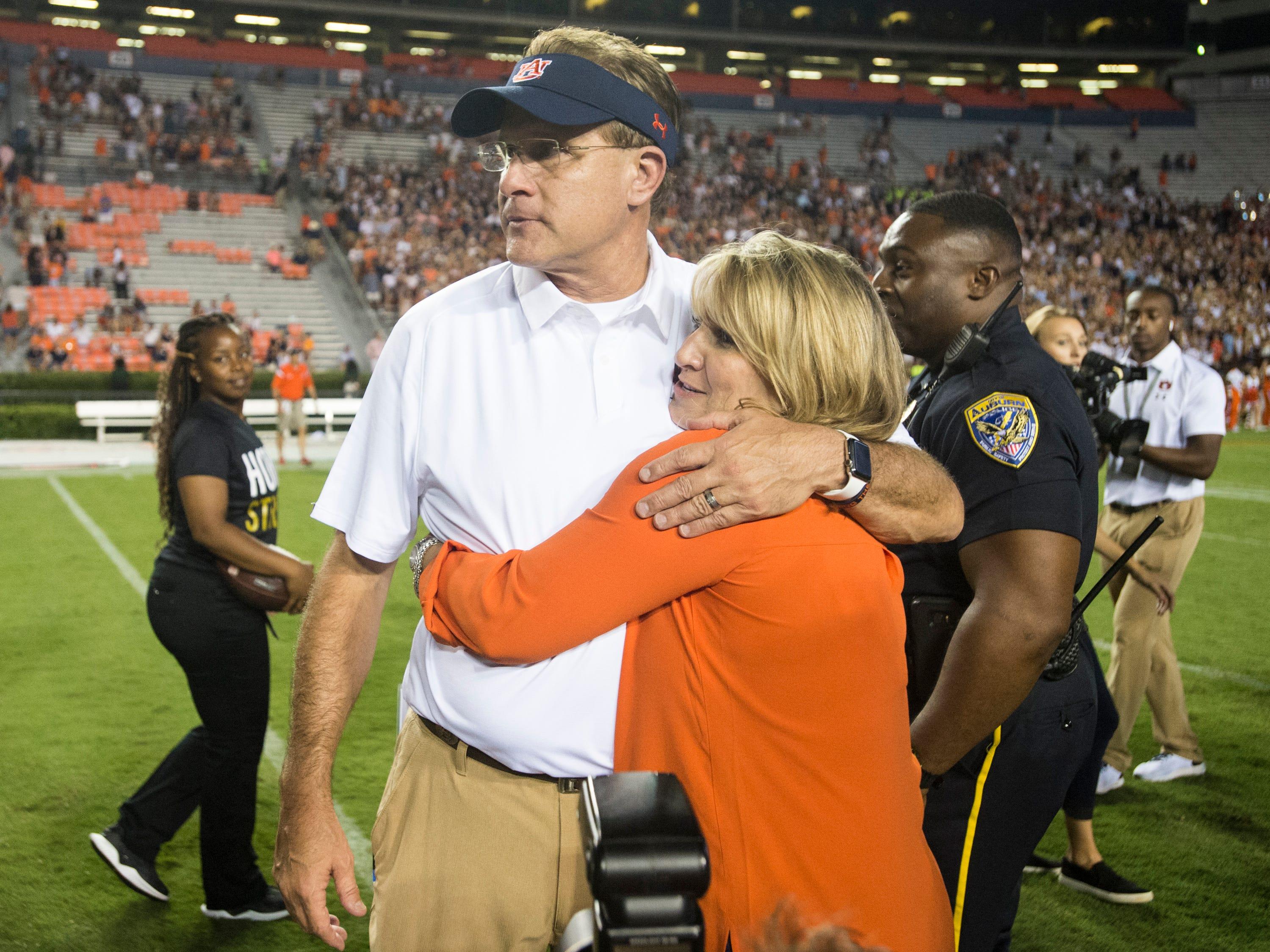 Auburn head coach Gus Malzahn hugs his wife, Kristi, after the game at Jordan-Hare Stadium in Auburn, Ala., on Saturday, Sept. 8, 2018. Auburn defeated Alabama State 63-9.