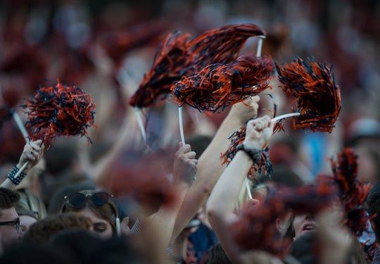 Auburn fans wave their pompoms at Jordan-Hare Stadium in Auburn, Ala., on Saturday, Sept. 8, 2018. Auburn defeated Alabama State 63-9.