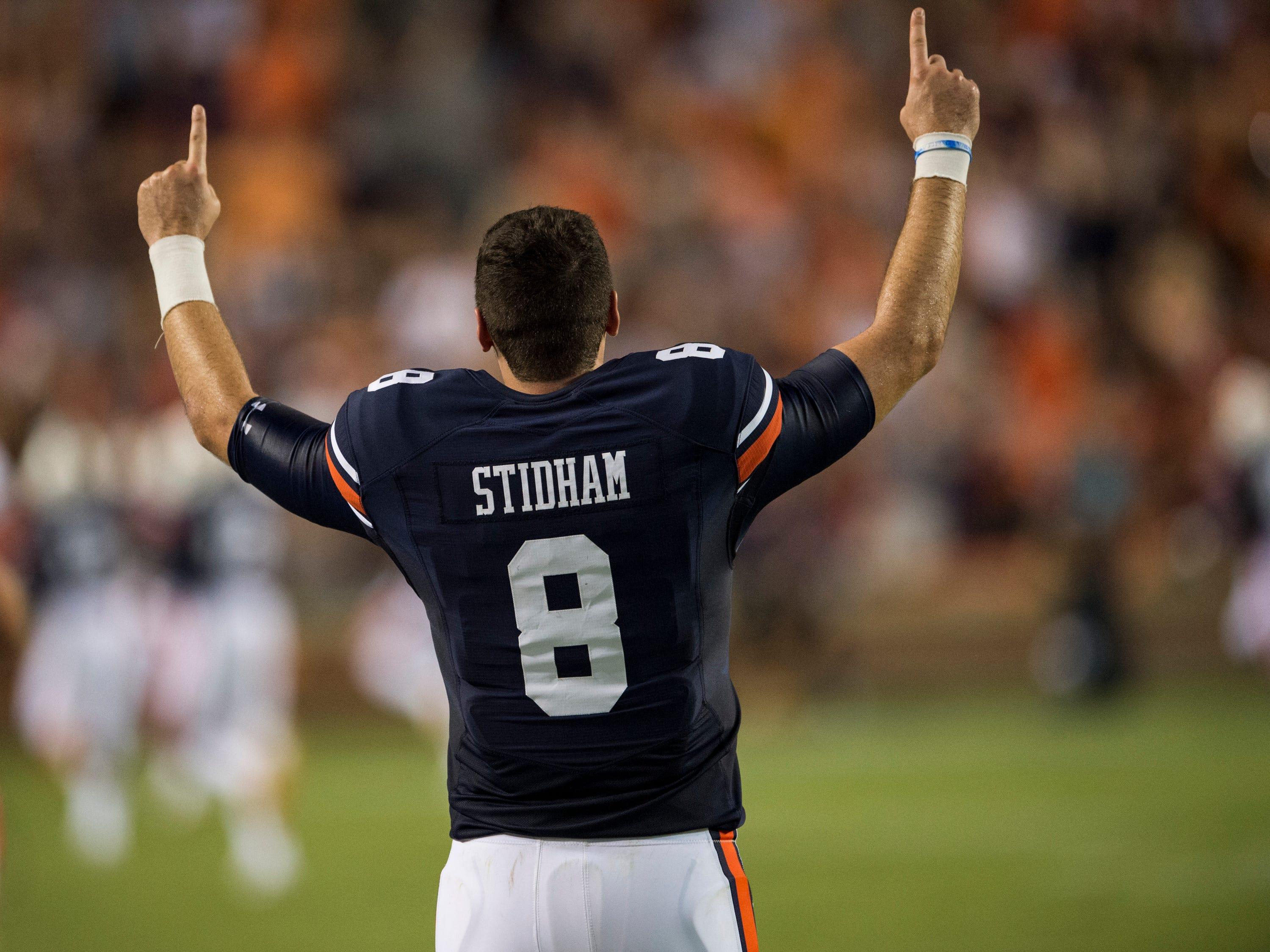 Auburn's Jarrett Stidham (8) celebrates as his defense intercepts the ball and scores a touchdown against Alabama State at Jordan-Hare Stadium in Auburn, Ala., on Saturday, Sept. 8, 2018. Auburn defeated Alabama State 63-9.