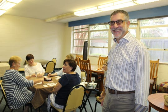"Temple Beth Or canasta players attract Rabbi Scott Looper in the ""audience."""