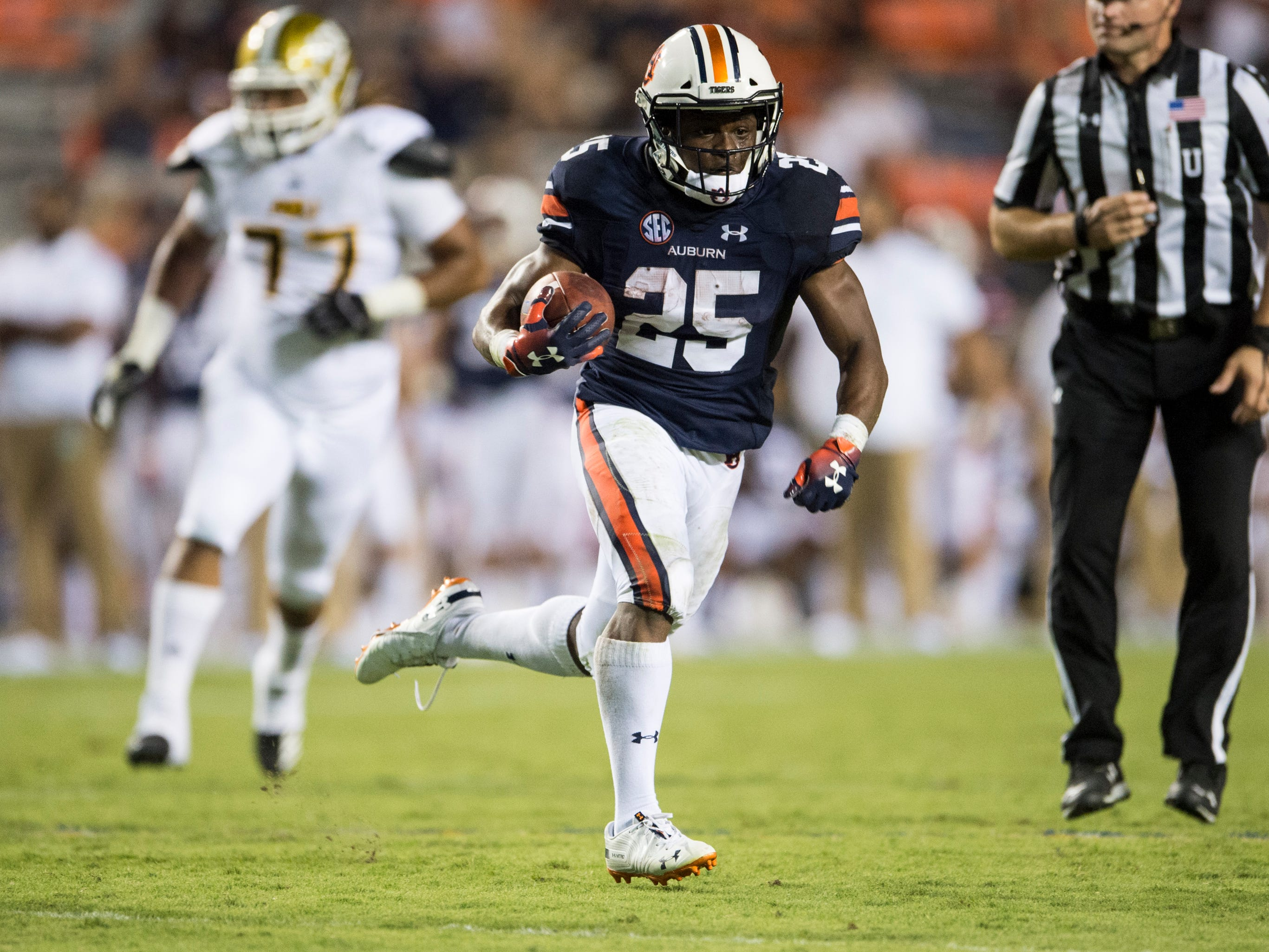 Auburn's Shaun Shivers (25) runs the ball in the open field against Alabama State at Jordan-Hare Stadium in Auburn, Ala., on Saturday, Sept. 8, 2018. Auburn defeated Alabama State 63-9.