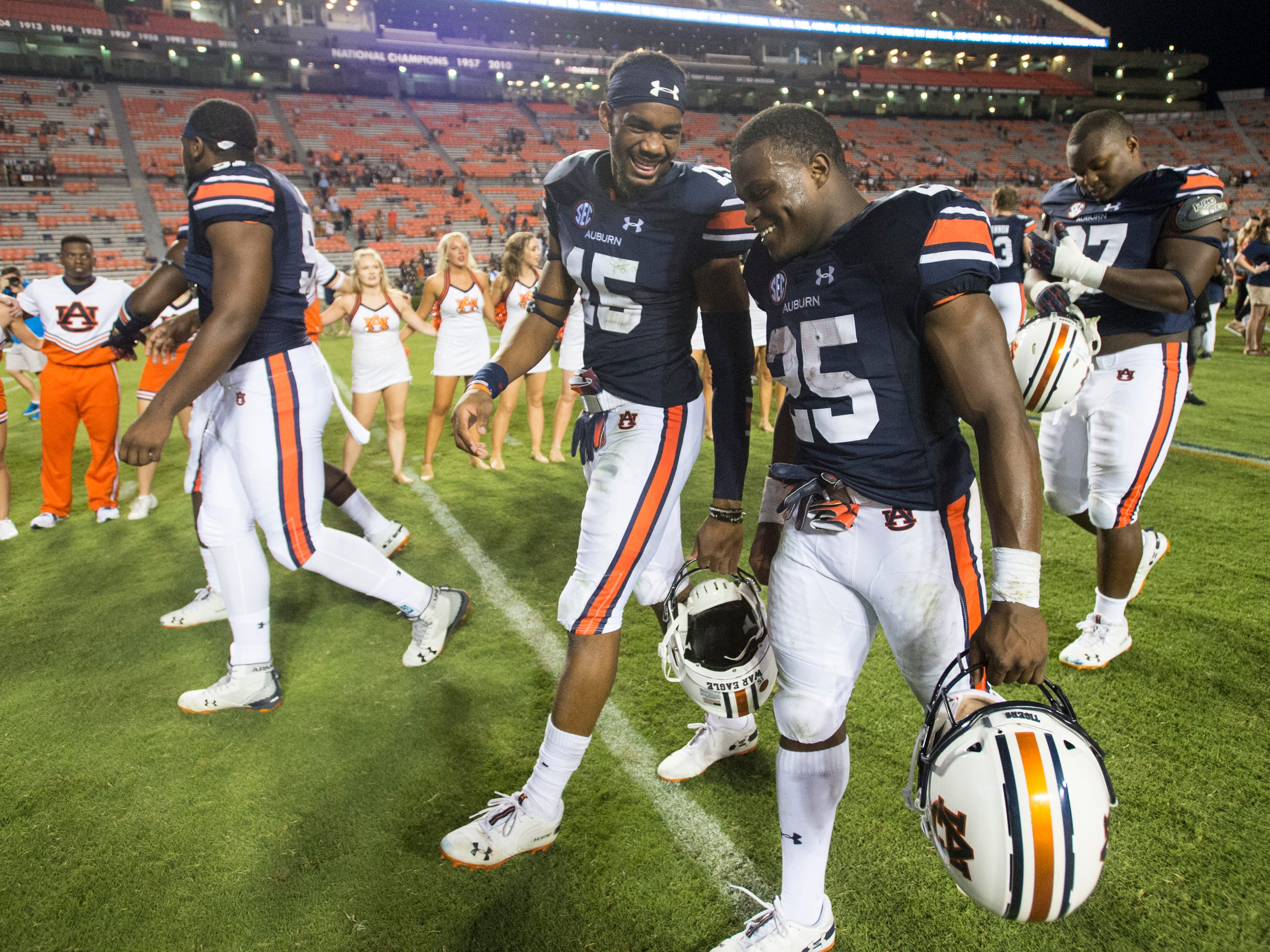 Auburn's Jordyn Peters (15) and Auburn's Shaun Shivers (25) walk off the field at Jordan-Hare Stadium in Auburn, Ala., on Saturday, Sept. 8, 2018. Auburn defeated Alabama State 63-9.