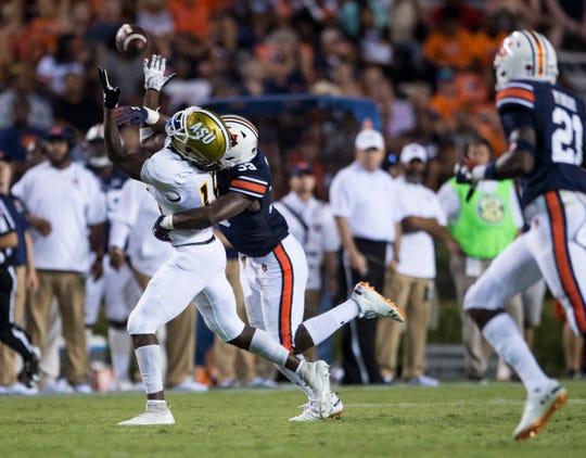 Alabama State's Jamir Hannah (18) bobbles the ball defended by Auburn's K.J. Britt (33) at Jordan-Hare Stadium in Auburn, Ala., on Saturday, Sept. 8, 2018. Auburn defeated Alabama State 63-9.