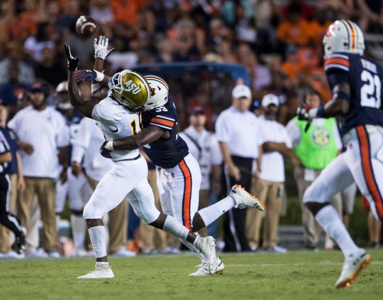 Alabama State's Jamir Hannah (18) bobbles the ball defended by Auburn's K.J. Britt (33) at Jordan-Hare Stadium in Auburn, Ala., on Saturday, Sept. 8, 2018. Auburn defeated Alabama State 63-9.