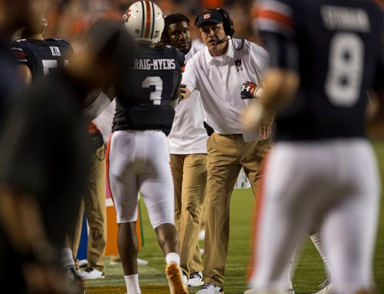 Auburn head coach Gus Malzahn high fives players as they come off the field at Jordan-Hare Stadium in Auburn, Ala., on Saturday, Sept. 8, 2018. Auburn defeated Alabama State 63-9.
