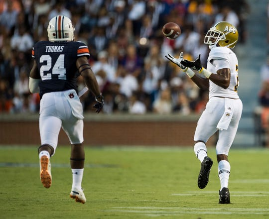Alabama State's Dieuly Aristilde, Jr. (2) catches a long pass guarded by Auburn's Daniel Thomas (24) at Jordan-Hare Stadium in Auburn, Ala., on Saturday, Sept. 8, 2018. Auburn leads Alabama State 42-2 at halftime.