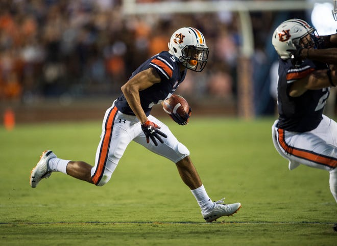 Auburn's Anthony Schwartz (5) runs to the outside against Alabama State at Jordan-Hare Stadium in Auburn, Ala., on Saturday, Sept. 8, 2018.