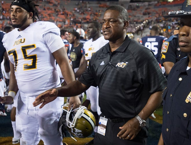 Alabama State head coach Donald Hill-Eley shakes hands with players after the game against  Auburn at Jordan-Hare Stadium in Auburn, Ala., on Saturday, Sept. 8, 2018. Auburn defeated Alabama State 63-9.