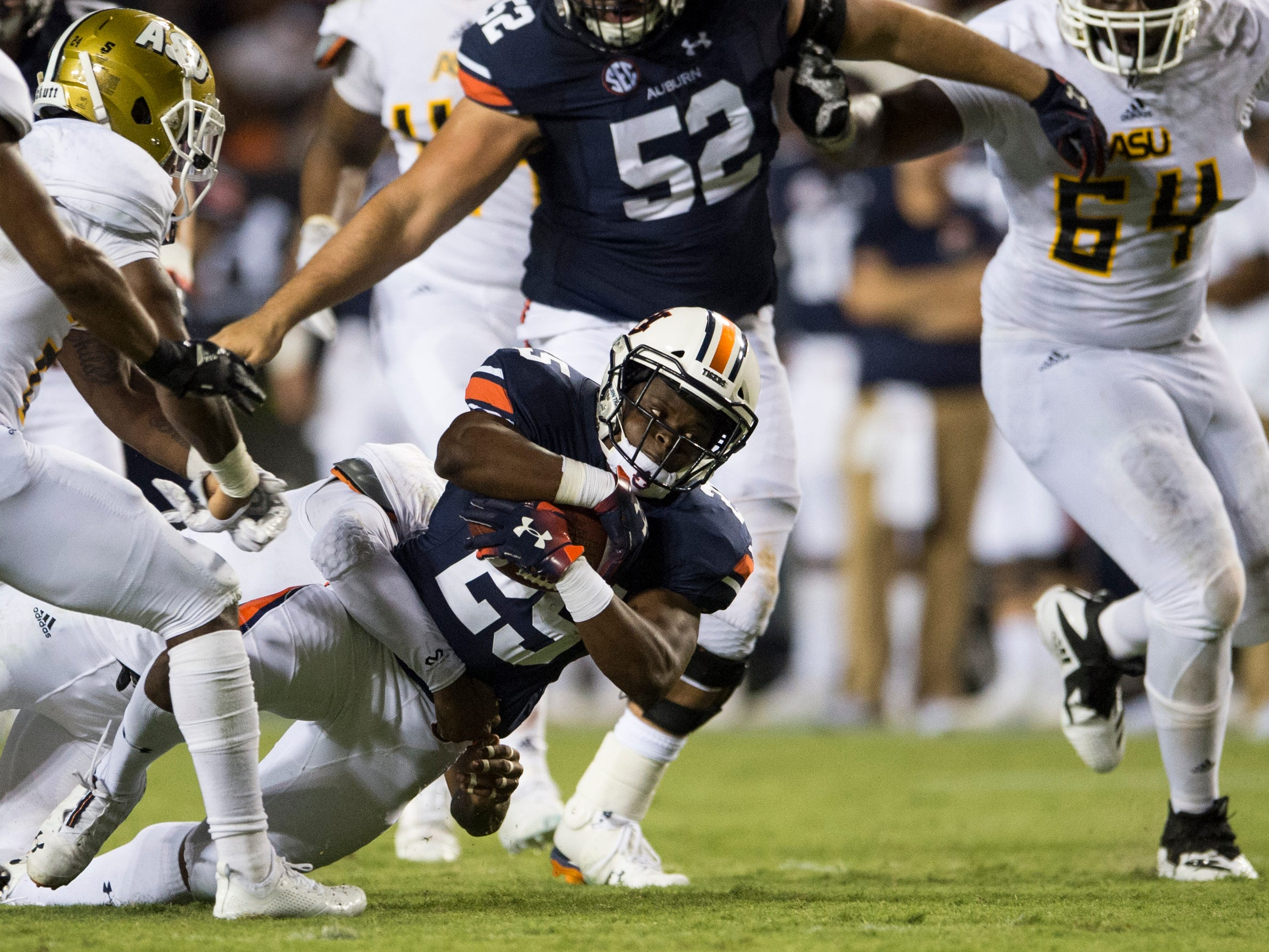 Auburn's Shaun Shivers (25) is tackled by Alabama State's Kurron Ramsey (47) at Jordan-Hare Stadium in Auburn, Ala., on Saturday, Sept. 8, 2018. Auburn defeated Alabama State 63-9.