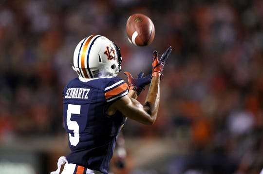 Auburn's Anthony Schwartz catches a long pass for a touchdown in the first half Saturday.