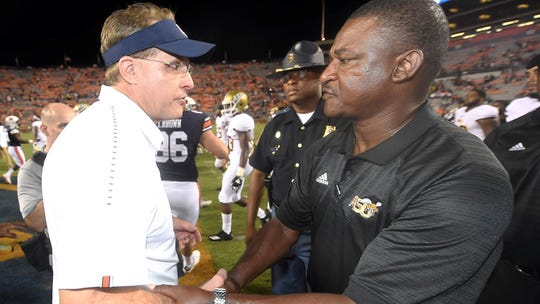 Auburn coach Gus Malzahn and ASU coach Donald Hill-Eley shake hands after the game.