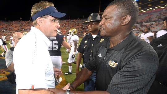 Auburn coach Gus Malzahn and ASU coach Donald Hill-Eley shake hands after the game.