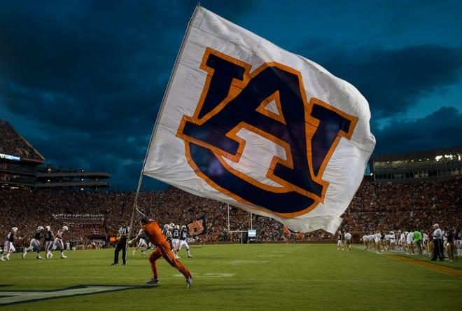 Auburn's flag is waved after an Auburn score at Jordan-Hare Stadium in Auburn, Ala., on Saturday, Sept. 8, 2018. Auburn defeated Alabama State 63-9.