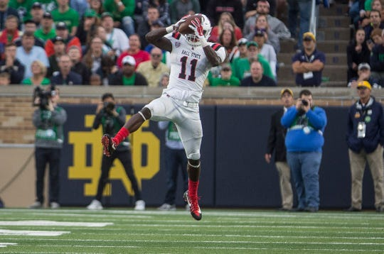 Ball State's Ray Wilborn makes an interception during the game against Notre Dame on Sept. 8. Ball State lost to Notre Dame 24-16.