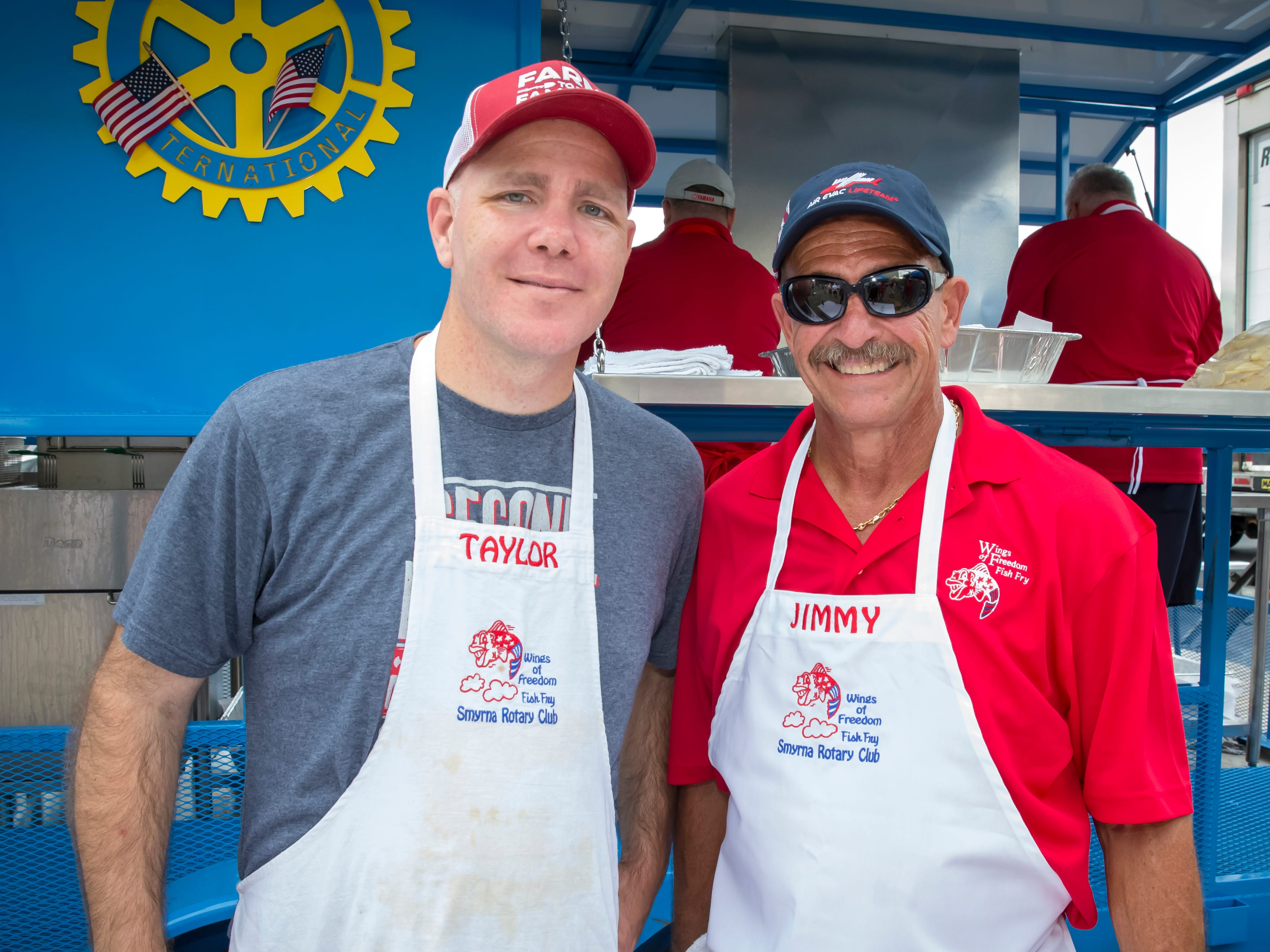 Taylor Loyal and Jimmy Driver at the Wings of Freedom Fish Fry hosted by Smyrna Rotary Club. The event was held at the Corporate Flight Management Hangar at Smyrna Airport.