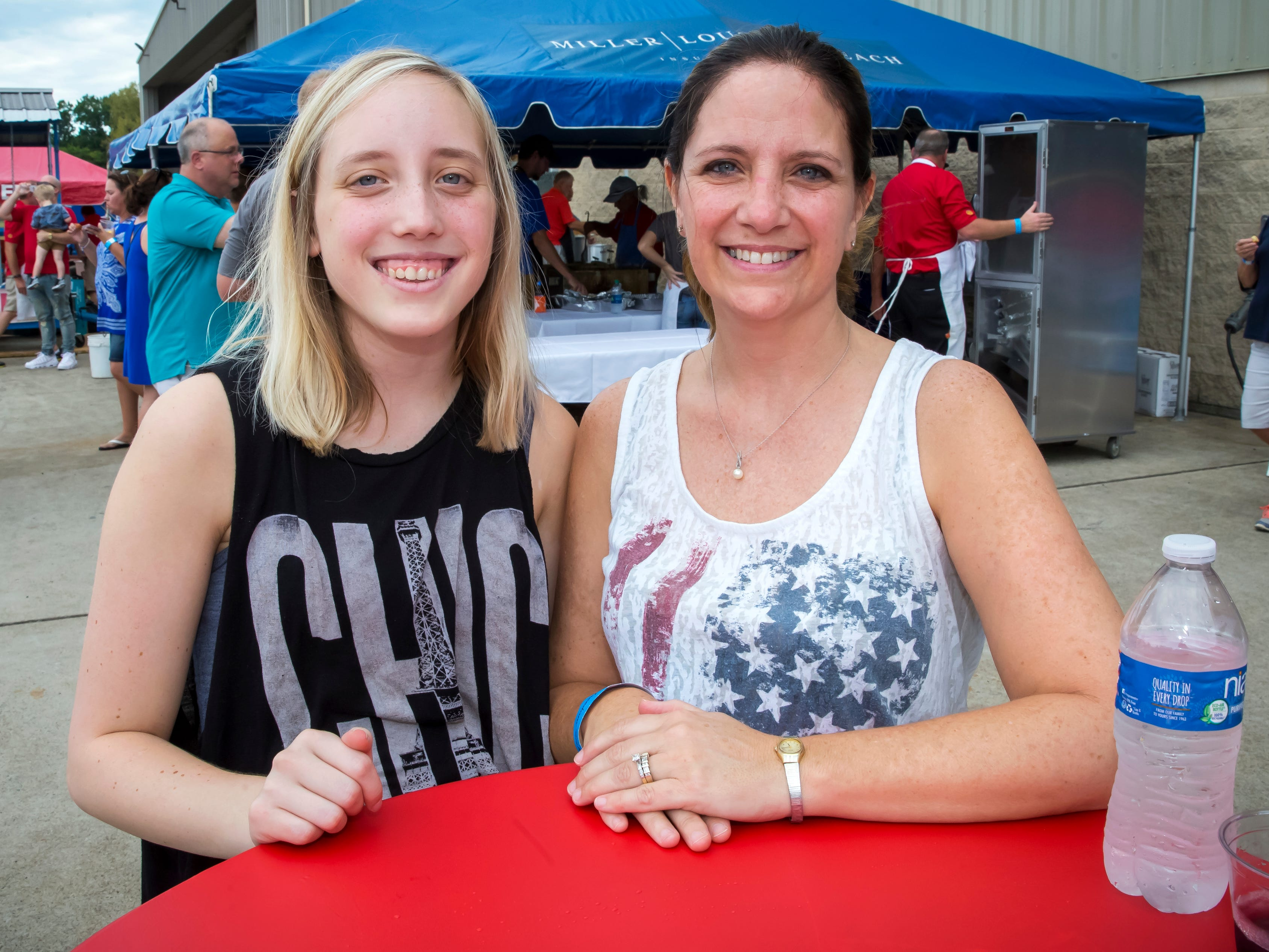 Heather and Shannon French at the 2018 Wings of Freedom Fish Fry hosted by Smyrna Rotary Club. The event was held at the Corporate Flight Management Hangar at Smyrna Airport.