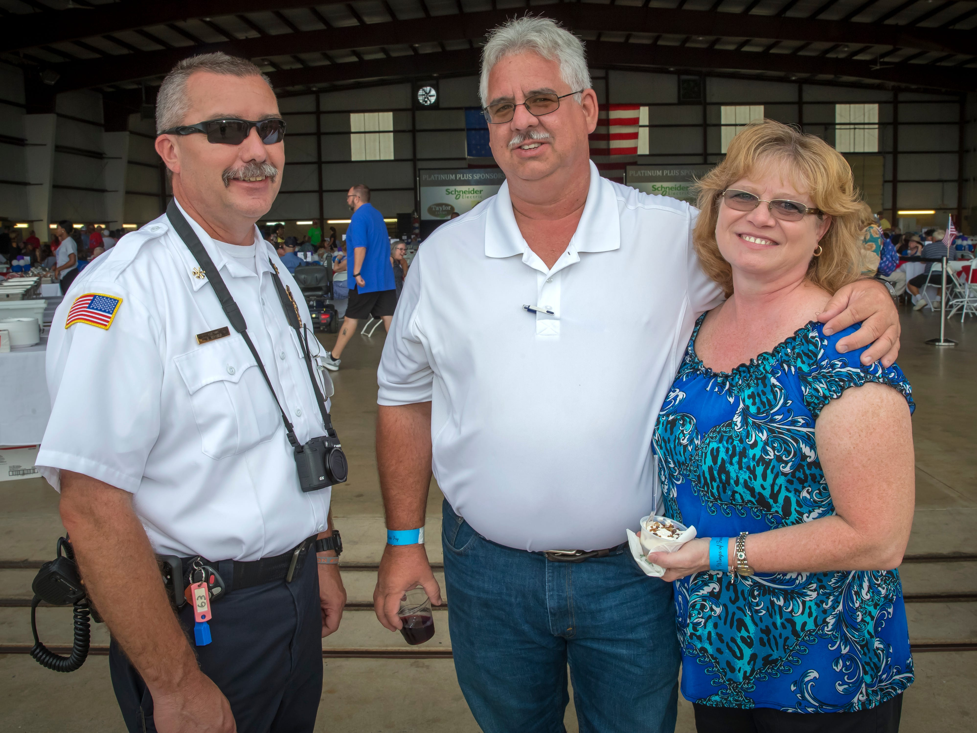 Ferris Belcher, Dana and Jennifer Blair at the Wings of Freedom Fish Fry hosted by Smyrna Rotary Club. The event was held Saturday, Sept. 8, 2018 at the Corporate Flight Management Hangar at Smyrna Airport.