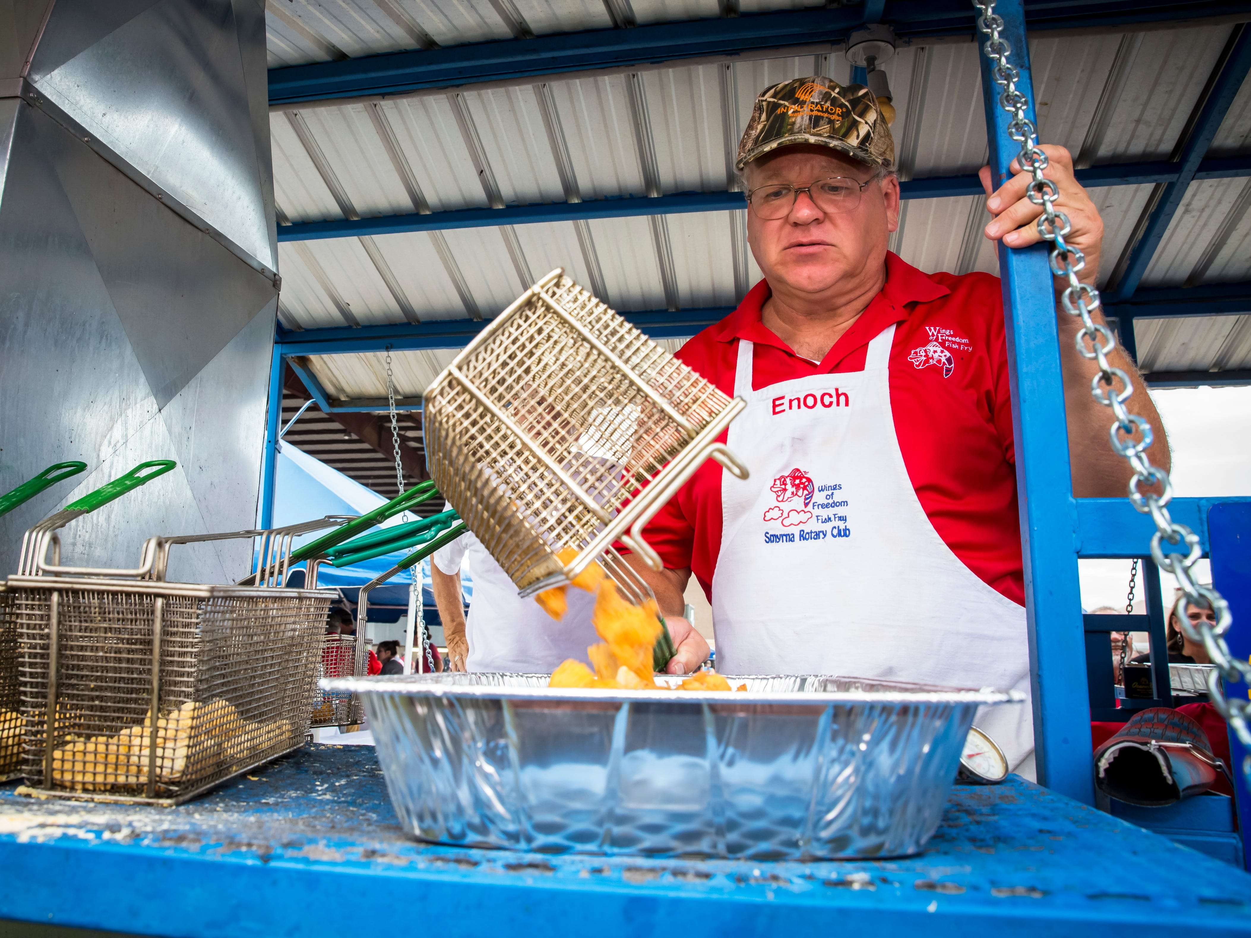 Enoch Jarrell prepares fish at the 2018 Wings of Freedom Fish Fry hosted by Smyrna Rotary Club Saturday, Sept. 8. The event was held at the Corporate Flight Management Hangar at Smyrna Airport.
