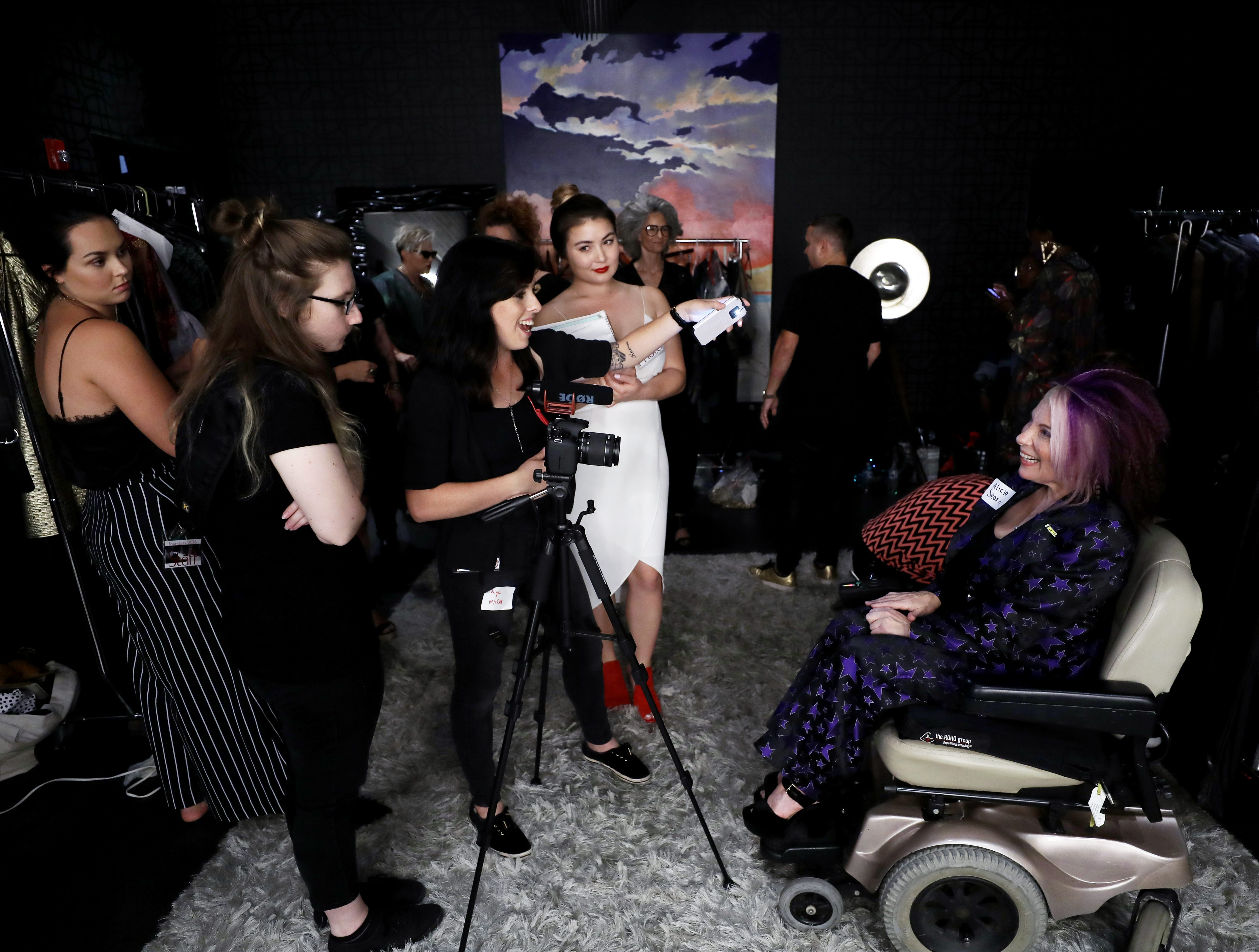 Alicia Searcy, right, organizer of the Boundless 2018 fashion show, is interviewed about the event at Studio 615 on Saturday, September 8, 2018.