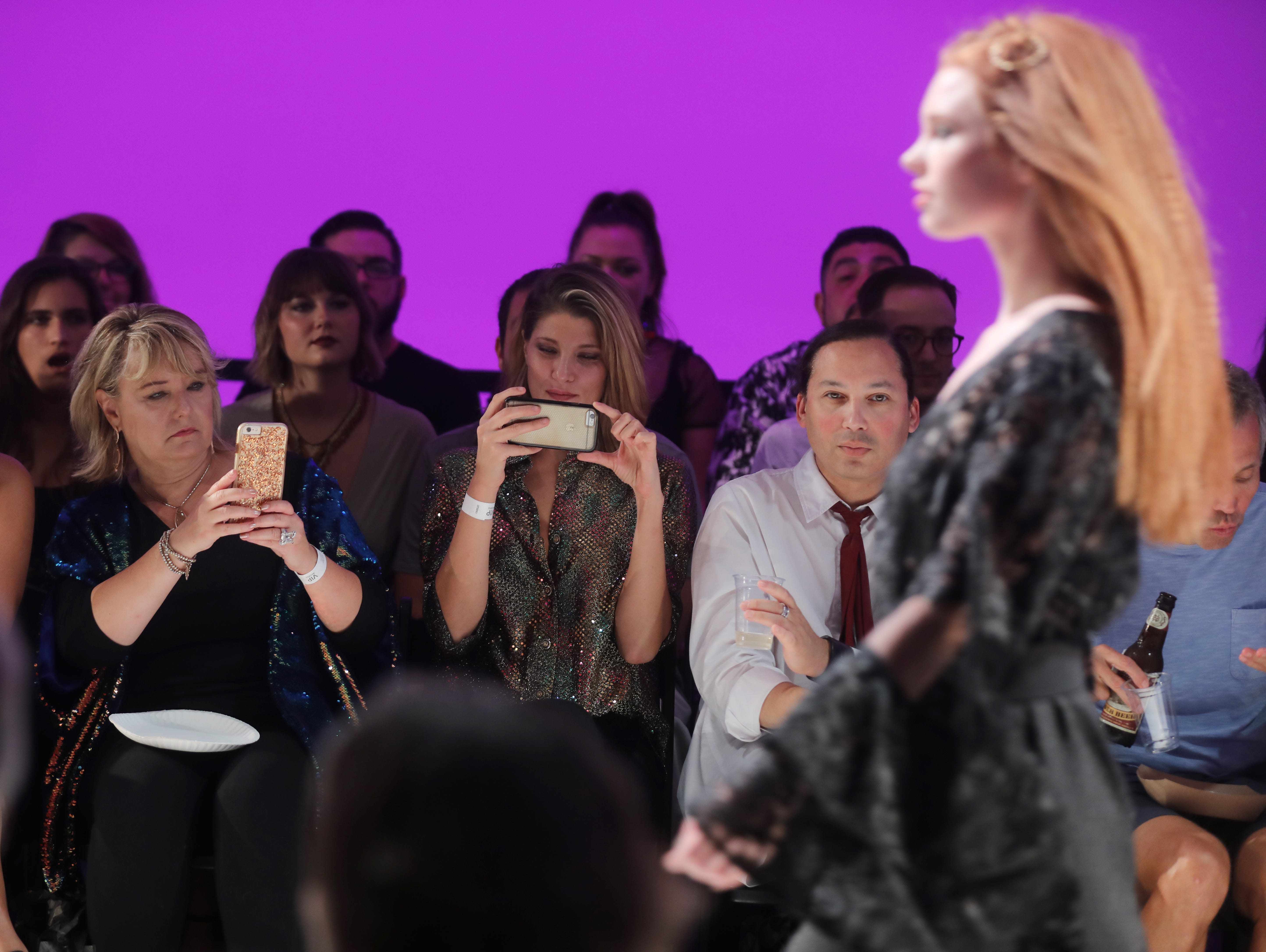 Members of the audience take photos during the Boundless 2018 fashion show held at Studio 615 on Saturday, September 8, 2018.