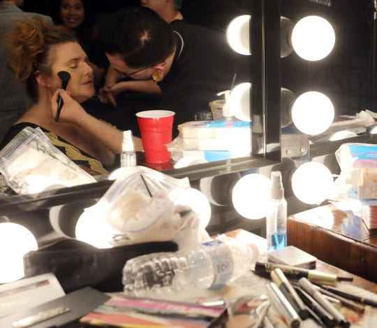 Tre Messina, right, applies makeup for Heidi Oechsel before the start of Boundless 2018 at Studio 615 on Saturday, September 8, 2018.