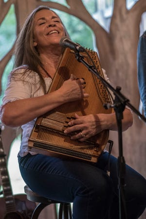 Carlene Carter plays her autoharp for the crowd that gathered for the dedication of the Smith-Carter House historical marker.