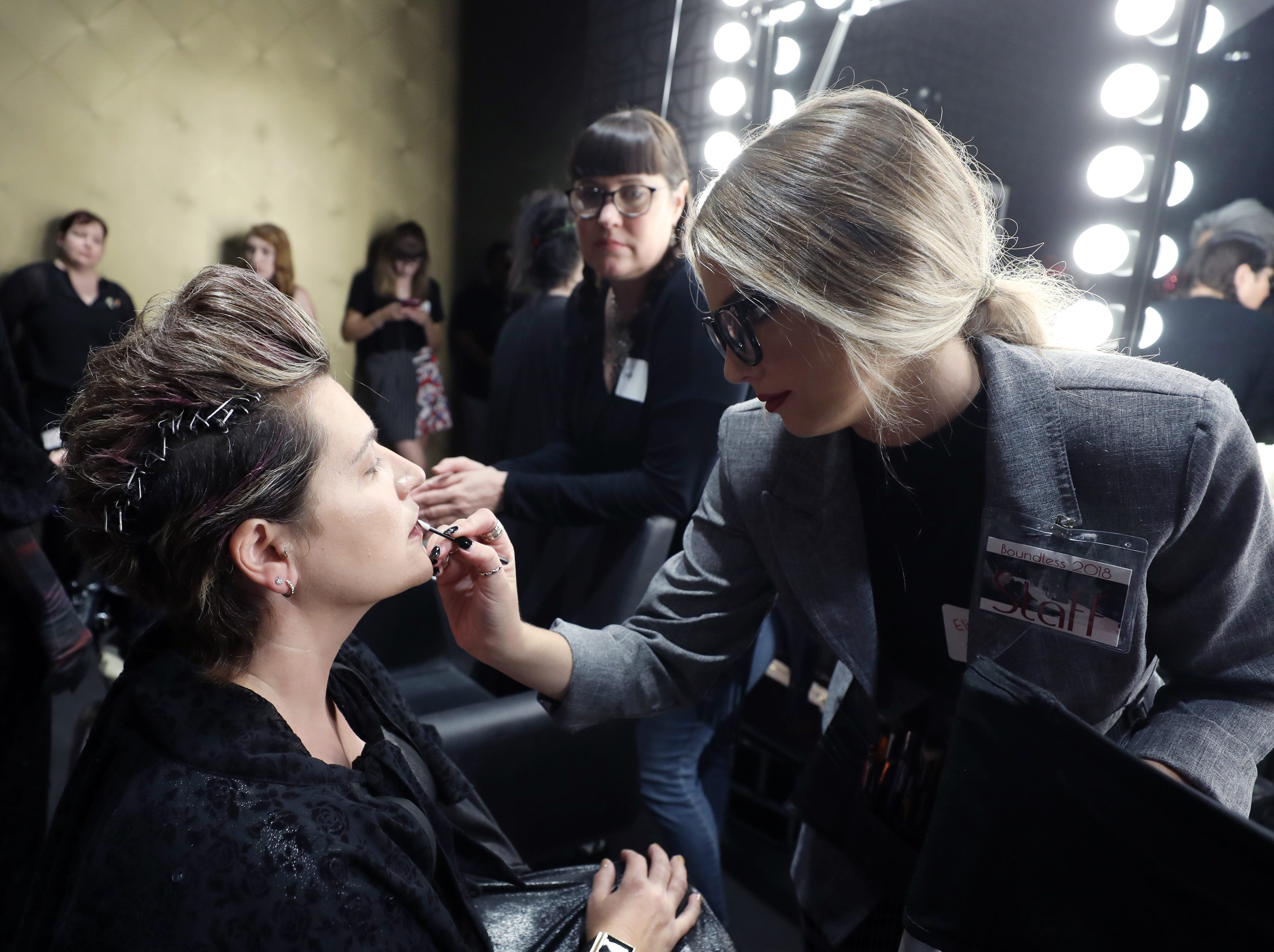 Elizabeth Wolf, right, applies makeup for Amy Burnett before the start of the Boundless 2018 fashion show held at Studio 615 on Saturday, September 8, 2018.