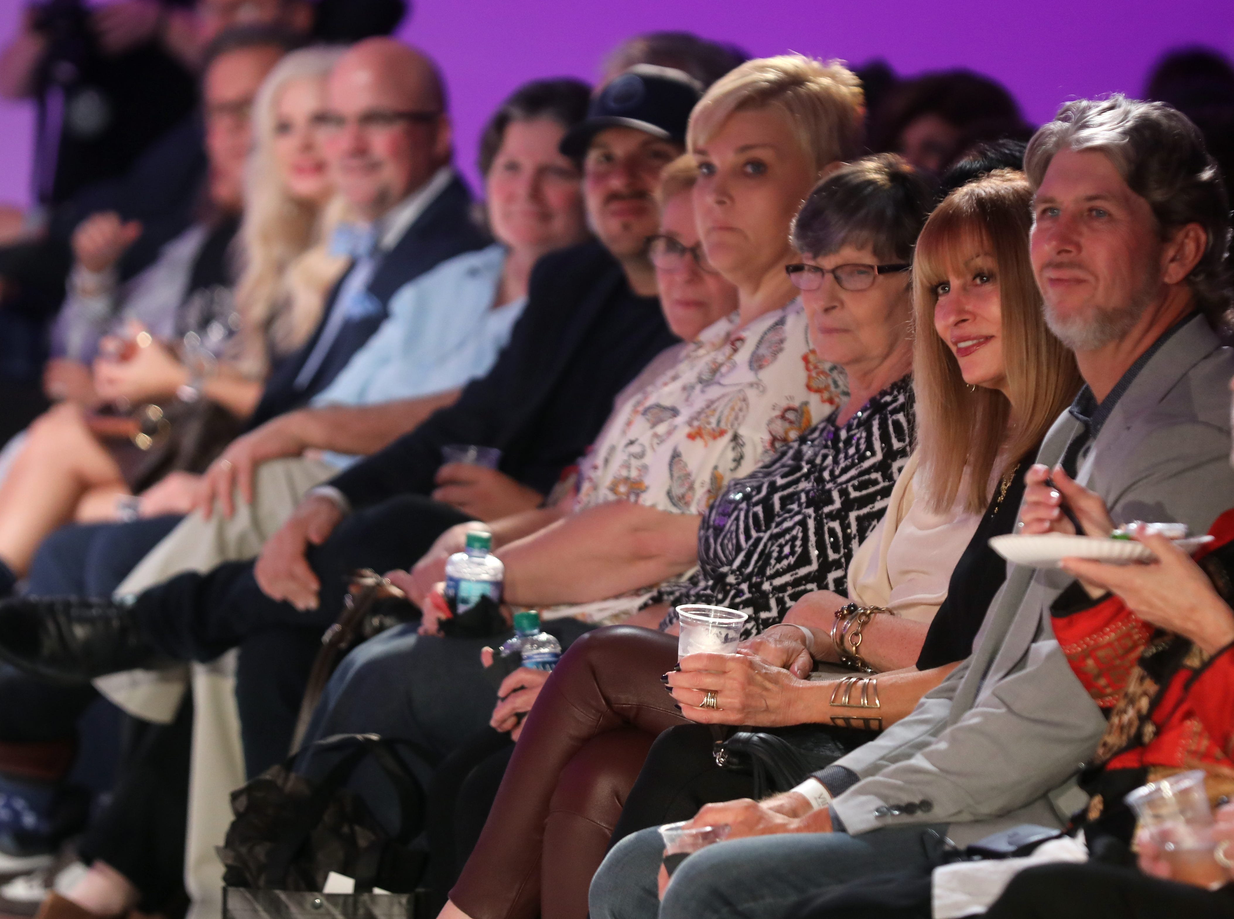 Audience members listen to Boundless 2018 organizer Alicia Searcy speak before the start of the fashion show at Studio 615 on Saturday, September 8, 2018.
