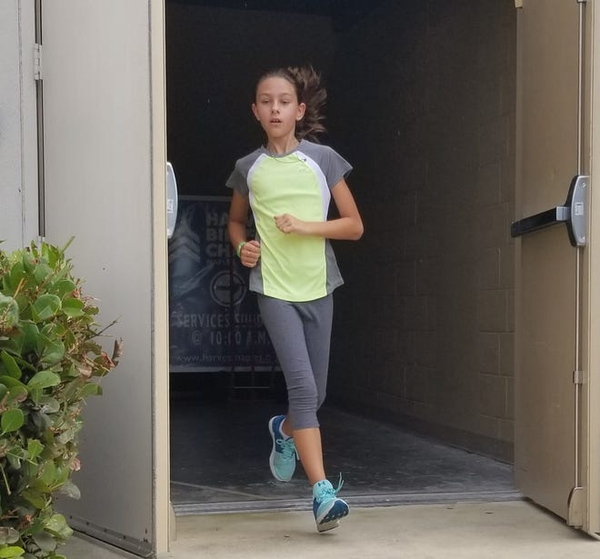 A young runner finishes a flight of stairs Sunday, Sept. 9, 2018, in memory of the first responders who climbed to rescue people trapped in the World Trade Center towers on Sept. 11, 2001.