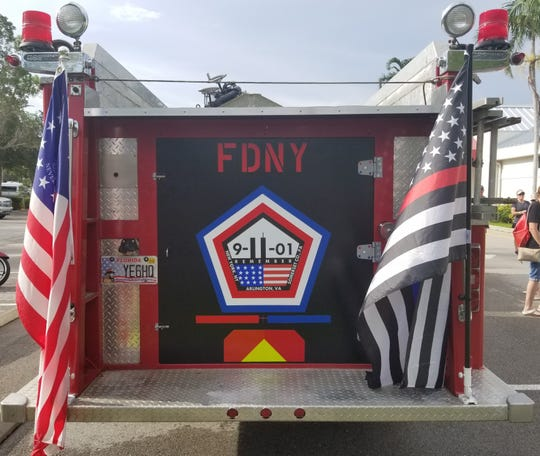 A fire engine that was in New York City at the time of the Sept. 11, 2001, terrorist attacks sits at the Greater Naples YMCA on Sunday, Sept. 9, 2018, to encourage runners taking part in a memorial stair climb.
