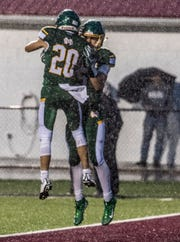Lucas Pierce celebrates with Grant Myers who just scored a touchdown for Newark Catholic in the first half of their game against Columbus Academy. Myers is a First Team selection for the 2018 All-Advocate Football Team.