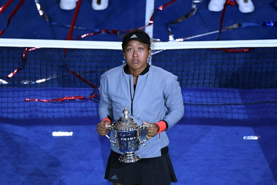 Sep 8, 2018; New York, NY, USA; Naomi Osaka of Japan tears up as she holds the championship trophy after defeating Serena Williams of the United States (not pictured) on day thirteen of the 2018 U.S. Open tennis tournament at USTA Billie Jean King National Tennis Center.