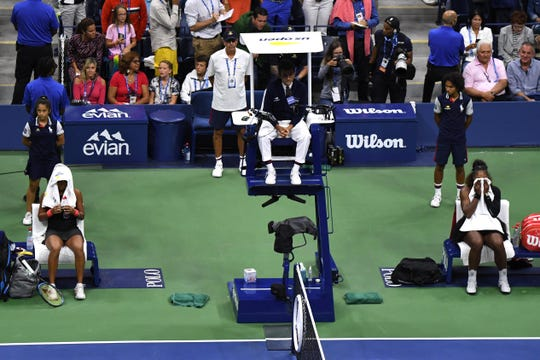 Sep 8, 2018; New York, NY, USA; (L-R) Naomi Osaka of Japan, chair umpire Carlos Ramos, and Serena Williams of the United States during the women's final on day thirteen of the 2018 U.S. Open tennis tournament at USTA Billie Jean King National Tennis Center.