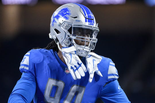 Aug 17, 2018; Detroit, MI, USA; Detroit Lions defensive end Ezekiel Ansah (94) warms up before a game against the New York Giants at Ford Field.