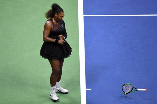 Sep 8, 2018; New York, NY, USA; Serena Williams of the United States smashes her racket during the women's final against Naomi Osaka of Japan (not pictured) on day thirteen of the 2018 U.S. Open tennis tournament at USTA Billie Jean King National Tennis Center.