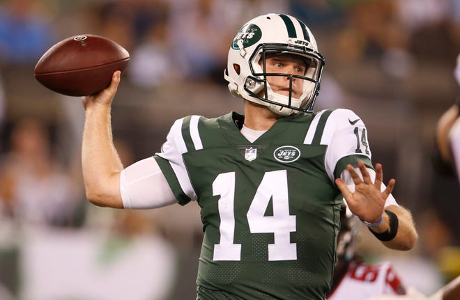 In this Aug 10, 2018, file photo, New York Jets quarterback Sam Darnold (14) throws a pass during the first half of a preseason NFL football game against the Atlanta Falcons in East Rutherford, N.J. Darnold will make NFL history when he jogs onto the field for the New York Jets on Monday, Sept. 10, 2018. The rookie will become the youngest quarterback to start a season opener in the Super Bowl era at 21 years and 97 days old at kickoff against the Lions in Detroit. (AP Photo/Adam Hunger, File)