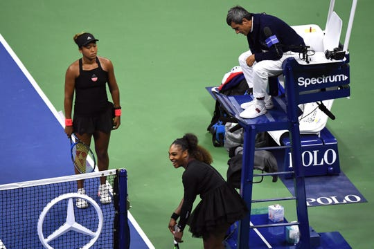 Sep 8, 2018; New York, NY, USA; (L-R) Naomi Osaka of Japan, Serena Williams of the United States, and chair umpire Carlos Ramos talk after Ramos charges Williams with a game penalty in the second set in the women's final on day thirteen of the 2018 U.S. Open tennis tournament at USTA Billie Jean King National Tennis Center.