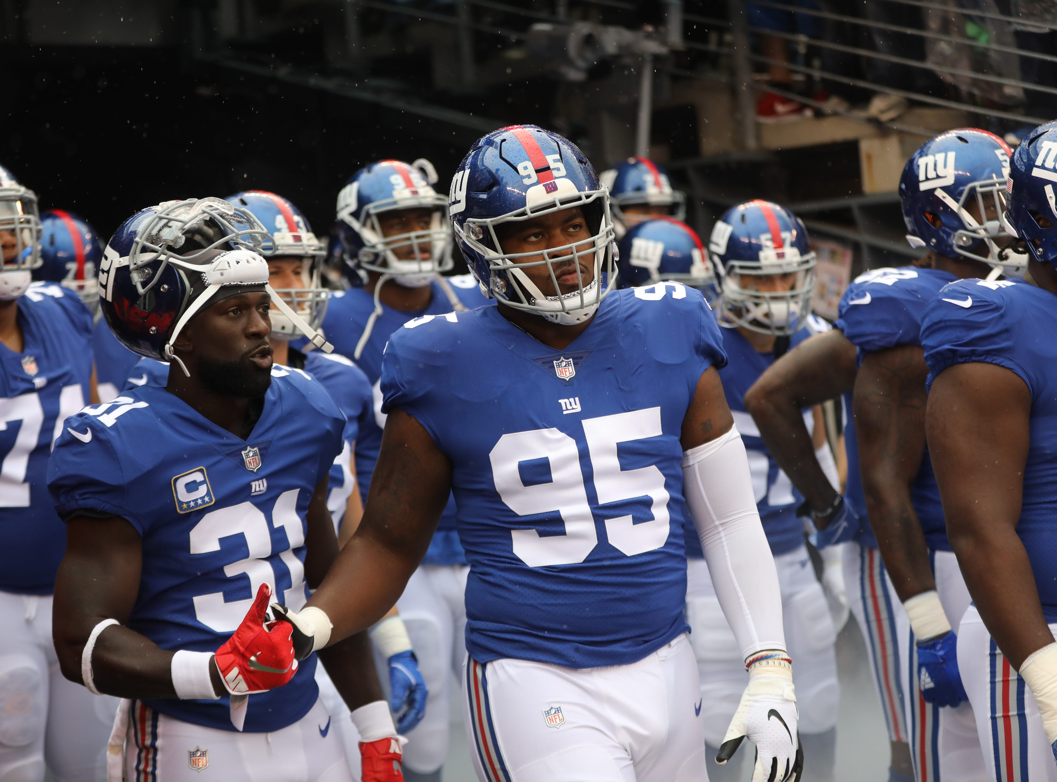 Michael Thomas (31), B.J. Hill (95) and the rest of the Giants get ready to take the field against the Jaguars in East Rutherford. Sunday, September 9, 2018