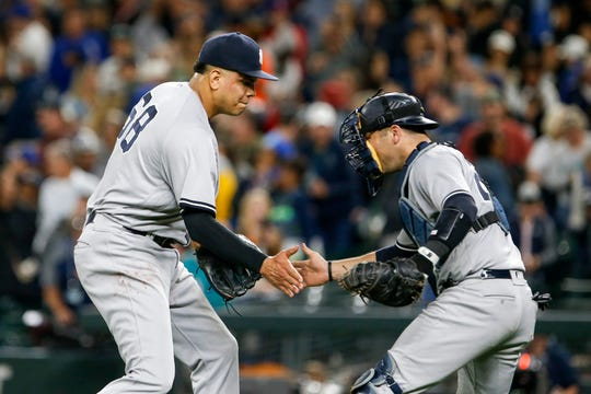 Sep 8, 2018; Seattle, WA, USA; New York Yankees relief pitcher Dellin Betances (68) celebrates with catcher Austin Romine (28) after getting the final out of a 4-2 victory against the Seattle Mariners at Safeco Field.