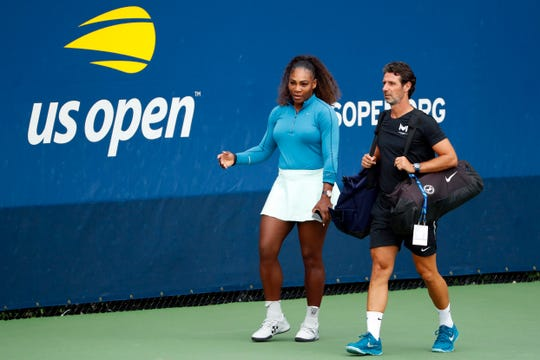 Serena Williams walks on a practice court with her coach Patrick Mouratoglou during the third round of the U.S. Open tennis tournament, Friday, Aug. 31, 2018, in New York.