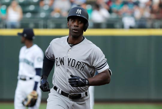 New York Yankees' Andrew McCutchen rounds the bases after he hit a solo home run during the first inning of a baseball game against the Seattle Mariners, Saturday, Sept. 8, 2018, in Seattle.